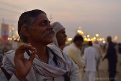 a smoker (gurpreet_singh.) Tags: life street india man face happy lights nikon looking bokeh expression cigarette smoking moustache shawl bidi allahabad beedi