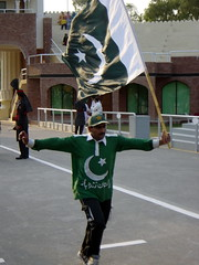 A Man Running with a National Flag at Wagah border ceremony, Pakistan (tyamashink) Tags: pakistan