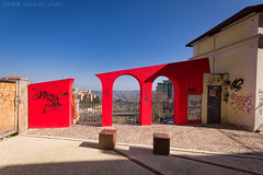 Broken Arches (Daniele Nicolucci photography) Tags: shadow red panorama house building art broken architecture landscape creativity graffiti arch view modernart arches cubes railing defaced defacing vandals abruzzo chieti hijacking viapapagiovannixxiii