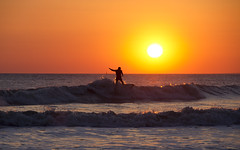 Sunset surf at Rest Bay (Tim Bow Photography) Tags: sunset orange yellow golden surf waves horizon wave british welsh svenska beautifulsunset intensecolours wintersurf welshsurfing timboss81 timbowphotography wintersunsetsurfporthcawl porthcawlsurfing silhoutteinthesun goldenfullsun
