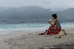 Lost in thought (Nora & Valdas) Tags: ocean travel sea vacation woman holiday beach girl female indonesia spectacular landscape lost island islands avocado sand asia thought sitting sad drink juice profile drinking deep thoughtful wave calm sit thinking tropical traveling gili sipping lombok tropics lostinthought gilitrawangan calmness sip immersed giliislands thoughs deepinthoughts