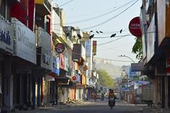Untitled (harshprk) Tags: street morning blue red sky people india colors birds bike nikon fort streetlife wires shops jaipur pidgins d5200