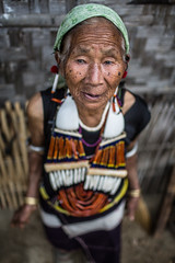 old woman of the angami tribe, wearing traditional clothing, near kohima, nagaland (anthony pappone photography) Tags: old portrait woman india wearing canon clothing traditional hut bracelets ethnic ritratto necklaces kohima nagaland tribu etnic angami angamitribe