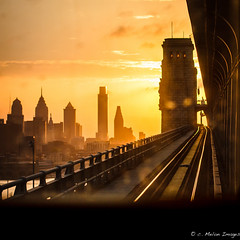 Ben's Spring View (Convicted Melon) Tags: street city railroad bridge light sunset shadow sun philadelphia window water lines silhouette skyscraper train canon square 50mm spring track dof bokeh dusk cityhall horizon symmetry philly patco libertyone libertytwo psfs comcastcenter aramark 2013