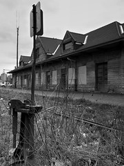 Bedford remnants... (VFR Photography) Tags: railroad bw history abandoned station tile bedford blackwhite carved weeds weed rust cut lock rusty indiana rail railway dry milwaukee vandalism rails target limestone depot historical locks rusting dried railways derelict queenanneslace railroads stations tiled in milw targets 1899 railroading weedy depots milwaukeeroad fallenflags lawrencecounty classi fallenflag partiallyrestored chicagomilwaukeestpaulpacific switchstand