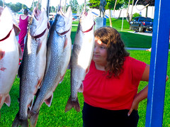 fishing27 (jonathan.carroll484) Tags: nadia nadiya girl spontaneous photo pic image looking closely inspection inspecting trout fish grand haven grandhaven michigan
