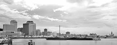 Skyline, Church and Barges (Neal3K) Tags: neworleans louisiana skyline skyscrapers sky barges church mississippiriver water bw blackwhite ir infraredcamera kolarivisionmodifiedcamera