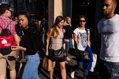 Oxford Street (Gary Kinsman) Tags: london w1 westend oxfordstreet candid streetphotography streetlife light crowd shopping consumerism lateafternoon bright 2016 fujix100t fujifilmx100t shadow fashion tshirt wolf