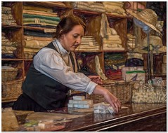 The millinery shop (Hugh Stanton) Tags: counter assistant clothes hats fabric
