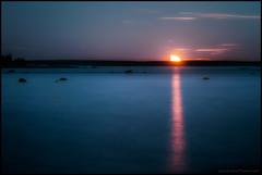 Moonset (Jonas Thomn) Tags: moon mnen moonset mnnedgng havet hav sea natt night clouds moln rocks stenar spegling refektion reflection vatten water