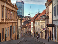 early birds (cherryspicks (intermittently on/off)) Tags: zagreb croatia street morning radiceva architecture building birds pastel cobblestone historic tower people citylife pigeon skyline urban