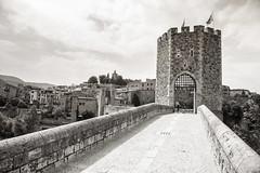 Besalu (LichtFreibeuter) Tags: spain catalonia village oldtown middleage old summer sun blackwhite bw monochrome street streetphoto streetphotography streetphotographer streetstory architecture house bridge stonebridge stonewall walls tower sightseeing turm mittelalter steinbrcke brcke huser strasenfotografie strasenfoto strasenkunst streetart art schwarzweis sw