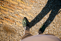 Under the pebbles (lorenzoviolone) Tags: finepix fujiastia100f fujix100s fujifilm fujifilmx100s ruins shoes vsco vscofilm x100s bricks mirrorless myself pebbles pointofview pov shadow streetphoto streetphotocolor streetphotography walk:rome=sep222016 roma lazio italy