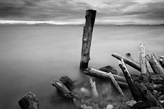 Ruins of wooden pillars at shore. Borneo, Sabah, Malaysia (Macbrian Mun) Tags: ocean wood old longexposure shadow sea wallpaper vacation sky blackandwhite white seascape storm abstract black texture abandoned beach nature water beautiful weather clouds composition contrast rural relax landscape outdoors pier wooden seaside sand ruins scenery long exposure waves moody gloomy slow natural outdoor background horizon fineart pillar perspective scenic wave stormy nobody calm structure pole shore silence malaysia borneo slowshutter shutter trunk weathered material lonely damaged plank planks sabah textured hardwood ruined