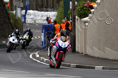 North West 200 (Diego Mola) Tags: road street bridge ireland irish black west girl bike sport race speed train canon eos women triangle nw action d corse hill north 7 diego racing motorbike international ii 600 200 7d moto motorcycle northernireland suzuki tt races northern ef gsx mola racer stradale portrush corsa gsxr superbike extender supersport ornella relentless dainese superstock motociclismo 2011 roadracer 14x dhu stradali agv 702004 nw200 canonef70200mmf4lusm roadraces canonefextender14xii ongaro varren diegomola tt3d ornellaongaro