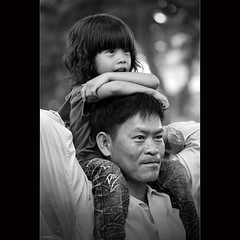 Fatherhood [ EXPLORED ] (-clicking-) Tags: blackandwhite bw love monochrome smile childhood portraits happy blackwhite faces bokeh father innocent daughter streetphotography happiness streetlife vietn