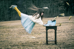 A story about flying (Kilkennycat) Tags: girl typewriter yellow writing canon children flying child turquoise airplanes royal levitation tights converse imagination typing capelet levitating 500d 100mm28 paperplanes kilkennycat t1i ryanconners
