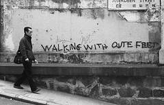 Walking with qute feet - Hong Kong (Lea_Williams) Tags: street film wall hongkong graffiti diy grain scan walker analogue rodinal homedeveloped v500 nikkormatel kentmere400 bwfp feb2013