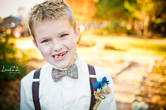 Enter: The Ringbearer (lunahzon) Tags: wedding silly love smiling happy sweet bowtie marriage naturallight ringbearer chewinggum suspenders playtime burlap missingtooth goldlight readytoparty sonofthebride redbonewillys lunahzonphotography waitingonthebride diyboutonniere bowtiesarecool charlotteareaphotographers