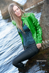 #254 Sea Wetlook with Blonde Girl in Wet Tight Jeans. Beautiful girl in green jacket and wet skinny jeans, blouse and