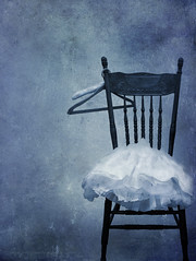 A frilly blue child's dress lies on an old wooden chair (Marlene's photography) Tags: blue childhood chair mood dress feminine empty nobody fancy littlegirl atmospheric hangers frilly frills crinoline partydress arcangelimages marleneford