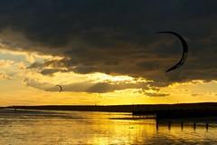 Sunset with kites (Keith Burton) Tags: sunset sea sun kite clouds sand hayling haylingisland kitesurfing kiteflying groyne cloudformations