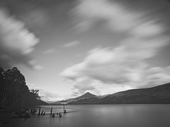 Skies over Schiehallion (spodzone) Tags: camera longexposure sky blackandwhite blur art nature monochrome clouds composition lens landscape photography scotland raw dynamic emotion unitedkingdom perthshire places rules appreciation equipment motionblur filter zen vista balance beyond serene awe striking fleeting simple toned pure contrasts turbulence elegance lochrannoch uplifting gbr rannoch circularpolariser creativeblur nearfar digikam landwater nd8 olympuspenf skyearth cloudappreciation rawconversion rawtherapee timeflows digitalred statesofwater olympus1260mmf28 motionstationary timefulness nearmidfardistance