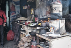 Cooking forests (johnelbrando) Tags: wood nepal 35mm fire momo nikon stove kathmandu 18 blockade momos deforestation