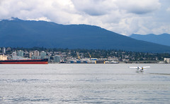 Burrard Inlet Take Off - Vancouver, Canada (The Web Ninja) Tags: vancouver bc british columbia canada canadian photo photography explore explored explorer travel canon canon70d 70d traveling color colour colors image colorimage vancouverbc britishcolumbia canadalandscape day daytime daylight clouds cloudy cloud seascape landscape sea ocean burrard inlet burrardinlet ferry boat boats city cityscape buidlings building coast mountain mountains vancity northvancouver northvan plane flying fly flight