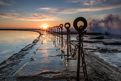 Old rock pool, Newcastle (Howard Ferrier) Tags: oceania merewether pool sunrise puddle newcastle australia contrejour chain splash elements water sea post sun pole ocean waves dawn newsouthwales pacificocean wall rust swimmingpool fence au materials astronomy themes time architecture