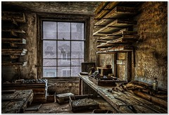 Abandoned workshop (Hugh Stanton) Tags: bench window appickoftheweek planks bottle trays tools pipes