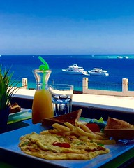 A tasteful breakfast on a great morning #morning #view #life #breakfast #fresh juice #Hurghada #redsea #egypt (granada.resturant) Tags: egypt morning view life breakfast fresh hurghada redsea