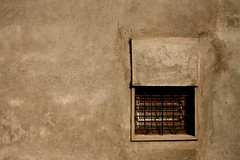 1245: The Small Opening (Atul Sabnis) Tags: flickr poeticsofspace kolhapur wall window ledge grey grill cracks cement concrete portfolio