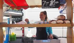 The herring girl. (abriwin) Tags: nl rotterdam blaak market stall herrings girl