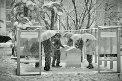 sNOw Smoking (Gulfu) Tags: life winter blackandwhite bw snow rain japan umbrella canon ginza 7d 1750 akihabara tamron snowshower freezingcold smokingzone snowphotography harshweather 10degree gulfuphotography 3degree snowfalltokyo