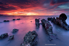 (Louise Denton) Tags: ocean longexposure blue sunset red sea orange water yellow sand rocks glow purple bright nt vibrant australia darwin barnacles jagged northernterritory mindilbeach louisedenton