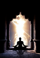 Yoga meditation in temple (Ressource Toi) Tags: travel sunset sky sun india man male nature silhouette sport yoga clouds pose relax temple freedom concentration healthy gate energy arch peace exercise lotus god religion buddhism calm stretch class inner health zen harmony mind sacred meditation spiritual relaxation fitness kazakhstan bizarre position connection chakra asana samadhi mental meditative pranayama padmasana