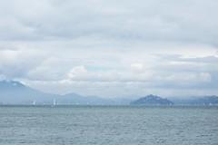 sailing into mist (wanderingstoryteller) Tags: sanfrancisco sea mist mountains sailboat