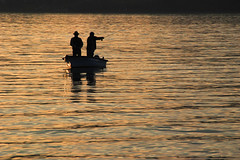 Fishing at sunset (Rich3012) Tags: lake lucerne luzern vierwaldstttersee switzerland swiss fishing fishermen boat silhouette sunset dusk casting