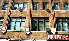 Liquors (Marina K Caprara) Tags: new york newyorkcity windows urban newyork color building brick film window architecture 35mm exterior open minolta openwindow liquor liquors parallel develop developing colorfilm