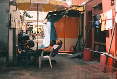 Afternoon Nap (mayrpamintuan) Tags: road street city travel sleeping summer urban sun streets history film tourism shop architecture analog shopping out walking asian outside outdoors lomo lomography singapore asia chinatown nap afternoon fuji tour market kodak outdoor sleep walk grain chinese lofi culture structures sunny tourist structure shops grains analogue roads grainy fujica lowres ultima lowfi filmphotography citytour filmisnotdead fujicast605n kodakultima100 kodakultima