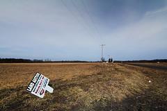 This land was my land... (bill.d) Tags: street sky house field sign michigan farm unitedstatesofamerica roadtrip dirt powerline telephonepole grandjunction
