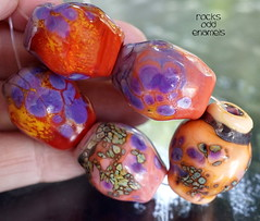 Rocks Odd Enamels (Laura Blanck Openstudio) Tags: openstudio openstudiobeads handmade lampwork glass beads murano jewerlry set big rocks nuggets whimsical funky odd colorful multicolor abstract earthy organic made usa fine arts art artist artisan show published winner transparent speckles raku frit shiny enamels enameled coral red orange yellow white lavender lilac grape purple violet copper green iridescent metallic sand beige ocher mango maize sherbet poppy