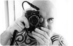 Camera and i. (CWhatPhotos) Tags: mono monochrome black white tattoo tattooed tattoos inked tribal chest shoulders selfee me photographs selfie have it photograph pics pictures pic picture image images foto fotos photography artistic that which contain digital cwhatphotos dark portrait body upper torso tatt ink pose face look beard samyang olympus em10 mk ii prime lens warrior curved curves bodyart