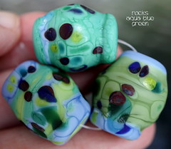 Rocks Aqua Blue Green (Laura Blanck Openstudio) Tags: openstudio openstudiobeads glass handmade lampwork beads set jewelry rocks nuggets pebbles stones etched matte glow opaque whimsical funky odd organic earthy abstract multicolor colorful transparent raku faceted speckles frit fine arts art artist artisan made usa published winner show festival kiln annealed aqua green blue turquoise lagoon ocean burgundy lapis periwinkle