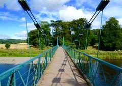 Suspension Bridge (heathernewman) Tags: dryburghabbey abbey bridge suspensionbridge river rivertweed tweed sunshine blue water green scotland scottishborders uk roxburghshire clouds outside landscape nature manmade arable