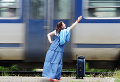 Young woman waving at train (its4adalina) Tags: bag women alone railways caucasian lady woman voyage sexy attractive travel dress railway wait transportation farewell pretty journey trip outdoor sunglasses railroad style standing summer modern young female traveler student handbag urban beautiful baggage beauty smiling luggage adult happy track rails waiting suitcase transport fashion train glamour nature goodbye fit countryside