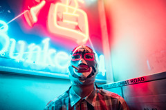 Transcendence (Jon Siegel) Tags: nikon d810 sigma 24mm 14 sigma24mmf14art man boy mask masked rider maskedrider wildman crazy smoking cigarette smoke neon light luminance chinese singapore singaporean evening night people urban city