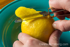 Hands peeling a lemon (Remsberg Photos) Tags: cooking kitchen fruit cuisine lemon peeling hand flavor inspection touch maryland experience produce taste sour discovery culinary investigate peeler discover investigation inspect fallston kinesthetic sensory lemonzest nestedbowls