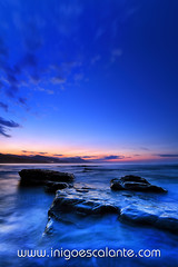She rocks blue (Iigo Escalante) Tags: blue sunset sea sky espaa costa sun black sol water vertical azul stone clouds landscape atardecer coast mar spain agua rocks waves negro silk paisaje national shore cielo nubes reflejo planet conde lonely fotografia seashore olas bizkaia seda vasco euskadi geographic vizcaya rocas pais norte nast piedras traveler cantabrico cantabric iigoescalante